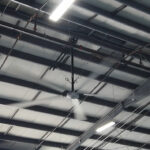 large industrial hvls fan cooling down a warehouse
