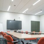 led lighting solutions being shown in a conference room