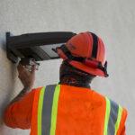 electrician installing an LED exterior light fixture