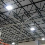 large industrial ceiling fan cooling down a warehouse